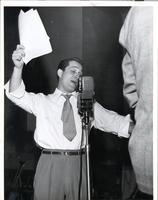 Perry Como singing into microphone