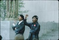 Two Black Panthers making Black Power gestures.