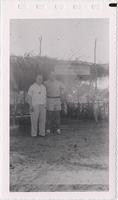 Two unidentified men standing in front of Liberian Customs