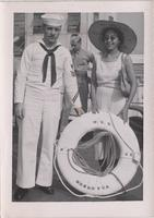 Orchid Jordan standing with an unidentified sailor