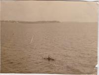 unidentified man canoeing