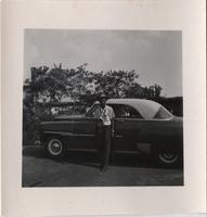unidentified man standing in front of a car