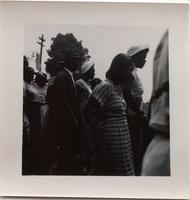 Unidentified people walking along a parade route