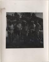 Five unidentified men in military uniforms