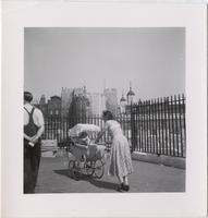 unidentified woman in front of the Tower of London