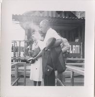 Leon Jordan with an unidentified man and woman on a wooden walkway