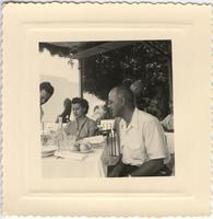 Leon Jordan and an unidentified woman at a restaurant