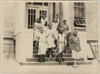 Ten young women outside an unidentified school