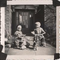Two little boys on tricycles