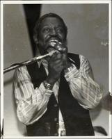 Jimmy Cheatham singing into a microphone