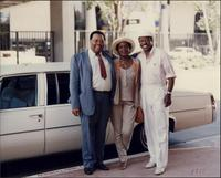 Jay McShann with the Cheathams beside a car