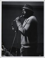 Thad Jones speaking into a microphone