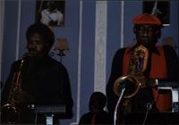 Rickey Woodard, Dinky Morris, and Ironman Harris performing