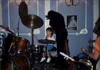 Toddler playing drums