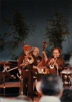 Jimmy Cheatham, Red Callender, and Snooky Young on stage