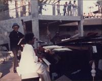 Jeannie Cheatham playing piano outside