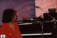 Jeannie Cheatham seated at a piano