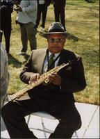 "Ahmad Alaadeen seated at the dedication of the Charlie Parker Memorial (""Bird Lives"")"