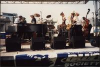 Jay McShann, Sonny Kenner, Ahmad Alaadeen, and Al Pearson on stage during the Kansas City Blues and Jazz Festival