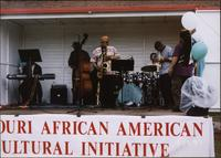 Ahmad Alaadeen and a band perform at an event sponsored by the Missouri African American Cultural Initiative