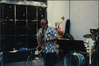 Ahmad Alaadeen performs with a jazz combo outdoors on the Country Club Plaza