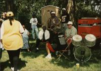 group of musicians waiting offstage at the outdoor concert venue of the 1993 Kansas City Blues & Jazz Festival