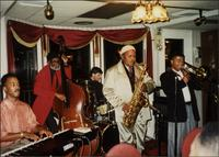 Everette Freeman, David Daahoud Williams, Ahmad Alaadeen, Matt Kane, and Tim Perryman performing