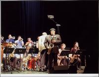 Ahmad Alaadeen performs with a student jazz band at the Gem Theater