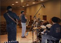 Will Matthews, Ahmad Alaadeen, and Gary Sykes rehearse in Malden, Missouri