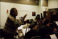 Ahmad Alaadeen explains a finer point to the music students at Clark County High School