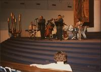 Everette Freeman, Ahmad Alaadeen, Ricky Anderson, Tim Perryman, and likely Don Mumford perform at a church