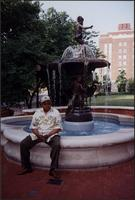 Ahmad Alaadeen sitting by Missouri Children's Fountain in front of the Governor's Mansion
