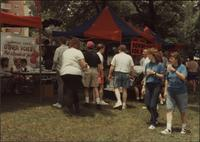 Looking at the booths at the GALA '91 Picnic