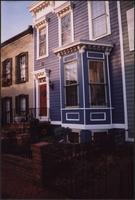 Bay windows on a blue house