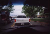 White pickup truck in traffic
