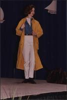 Yellow gold mid-length rain coat during the Boat Show Fashion Show