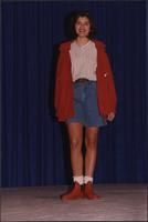 Stevens model wearing a rain jacket and jean shorts during the Boat Show Fashion Show