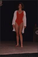 red swimsuit covered with a jacket at the Boat Show Fashion Show
