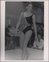 Swimsuit model on the runway during the Boat Show Fashion Show