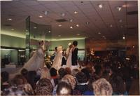 Six Stevens models stand on the runway together in wedding clothing