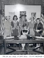 Harriette W. Cookingham and wives of department heads selling war bonds