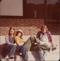 Sheila Stevens and friends relax on a curb