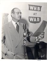 L. Perry Cookingham behind WHB microphone