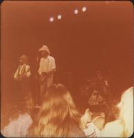 band, likely ZZ Top, performs on stage