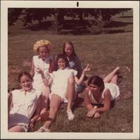 Sheila Stevens and her friends relax during a field day at St. Teresa's Academy