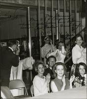 Flo Stevens and others backstage at a pageant