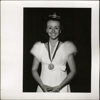Patricia Stevens with tiara and medallion