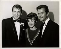 Dick Clark with two other people