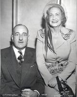 L. Perry Cookingham sits next to Mrs. Noel Wood