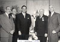 L. Perry Cookingham, William Kemp, and 3 unidentified men in business attire standing